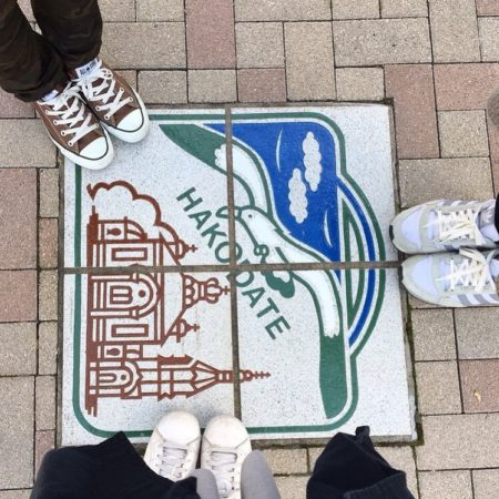 Hakodate road sign and sneakers