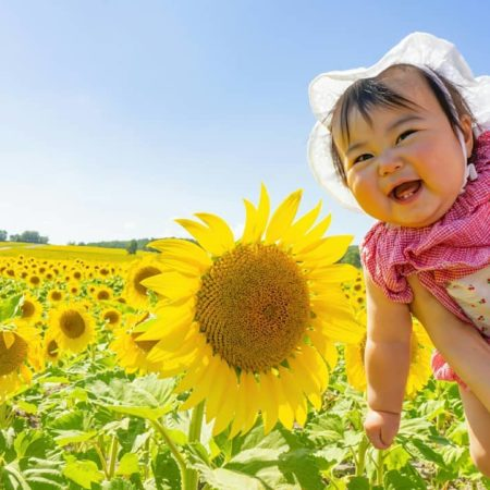 Sunflower and smiling baby