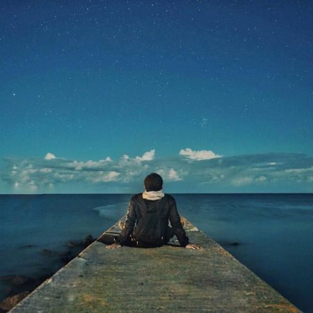 Man enjoying sea and starry sky in Monbetsu