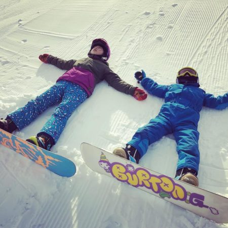 Children enjoying snow boarding in Iwanai
