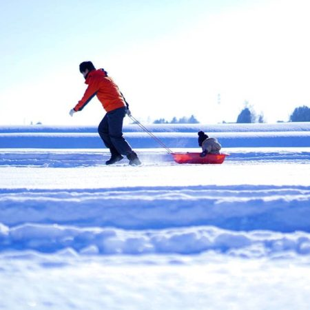 Child enjoying sledding