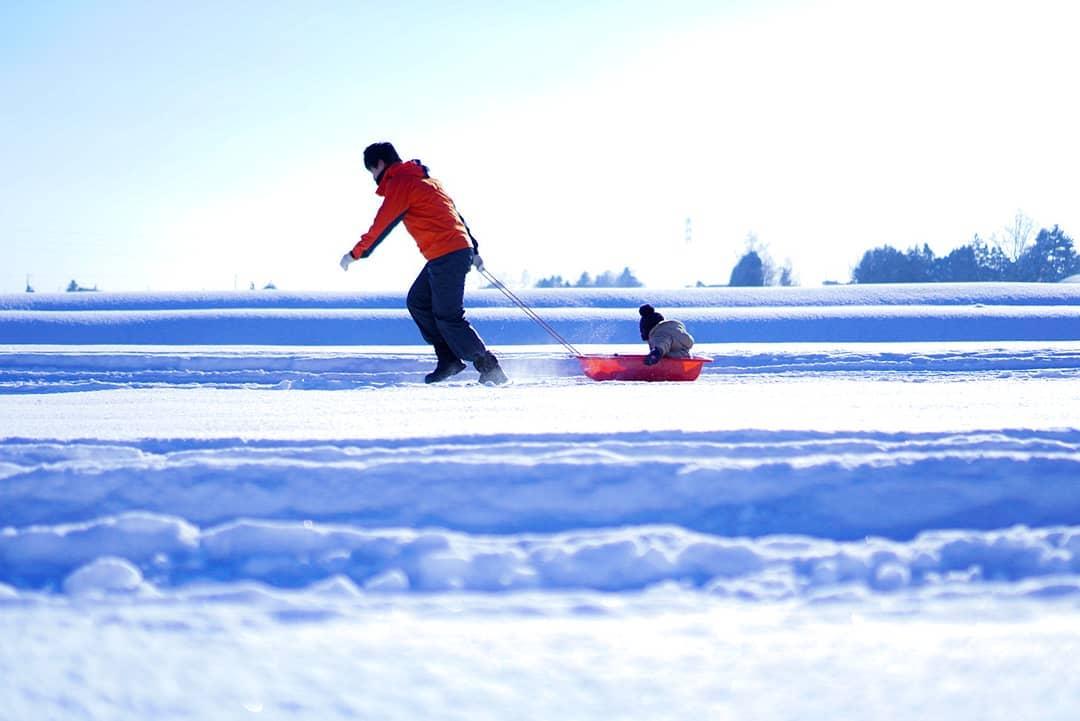 Child enjoying sledding