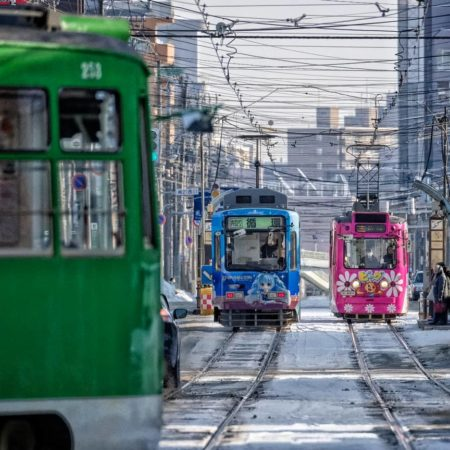 Three trams running in Sapporo