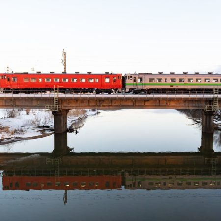 Image of train reflected in water