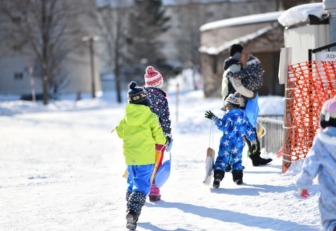 Children loving playing on sled