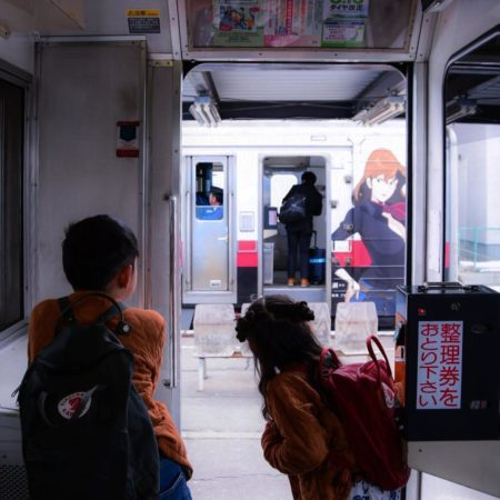 Children looking at outside of train