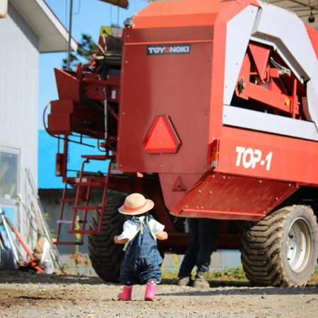 Girl and agricultural machinery in Taiki